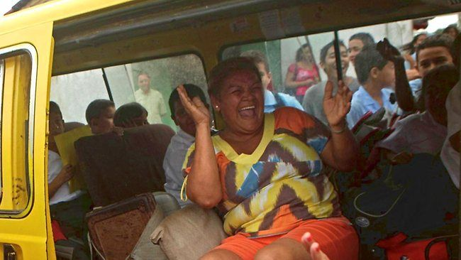 A woman laughs inside a van in Panama, which along with Paraguay, has the happiest people in the world. (AP Photo/Arnulfo Franco)
