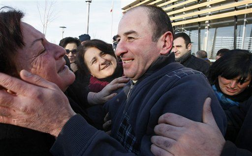 Relatives hug a former prisoner as he leaves Gldani prison No. 8 in Tbilisi, Georgia, Sunday, Jan. 13, 2013. Nearly 200 inmates considered political prisoners by Georgia's new parliament have walked free under an amnesty strongly opposed by President Mikhail Saakashvili. Many of those who walked free on Sunday were arrested during anti-Saakashvili protests in May 2011. Others had been convicted of trying to overthrow the government or of spying for Russia. (AP Photo)