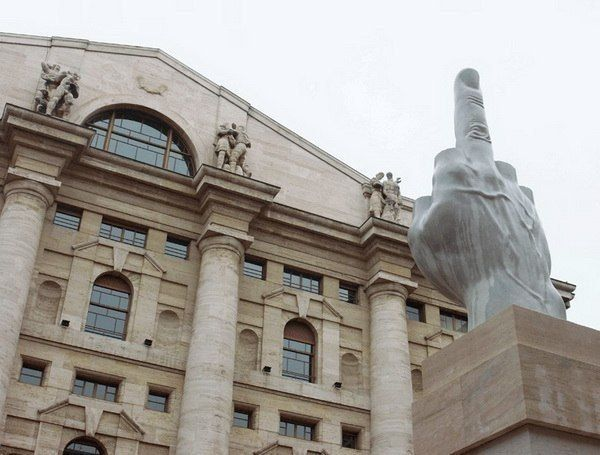 Middle finger in front of Stock Exchange bujilding in Milan