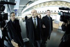 International Atomic Energy Agency chief inspector Herman Nackaerts (C) talks with journalists as he leaves for Iran on February 12, 2013 from Schwechat airport near Vienna, Austria
