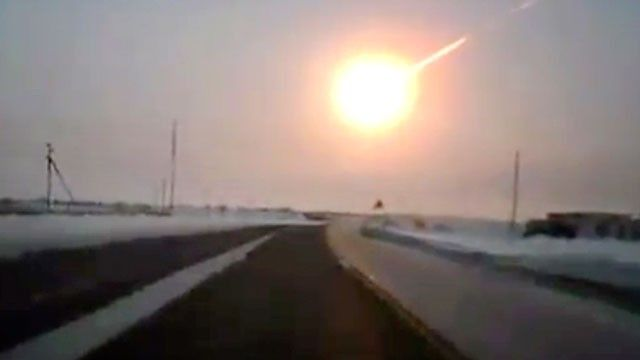 In this frame grab made from a video done with a dashboard camera, on a highway from Kostanai, Kazakhstan, to Chelyabinsk region, Russia, Feb. 15, 2013 a meteorite contrail is seen.