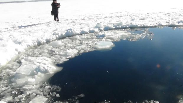 A circular hole in the ice of Chebarkul Lake where a meteor reportedly struck the lake near Chelyabinsk, about 930 miles east of Moscow, Russia, Friday, Feb. 15, 2013. Photo: Chelyabinsk Regional Branch of Russian Interior Ministry (AP)