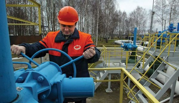 A worker turns a valve at the first pump station on Belarus territory of the Druzhba pipeline, near the village of Bobovichi, about 330 kilometres southeast of Minsk