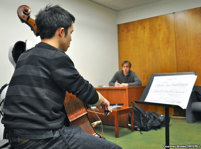 Composer David Fulmer and cellist Jay Campbell rehearse Fulmer's requiem for the victims of the 2011 Zhanaozen massacre in Kazakhstan.