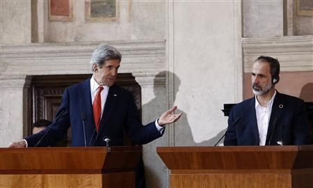 U.S. Secretary of State John Kerry (L) gestures next to Syrian National Coalition head Mouaz al-Khatib, Rome, February 28, 2013. Photo: Reuters
