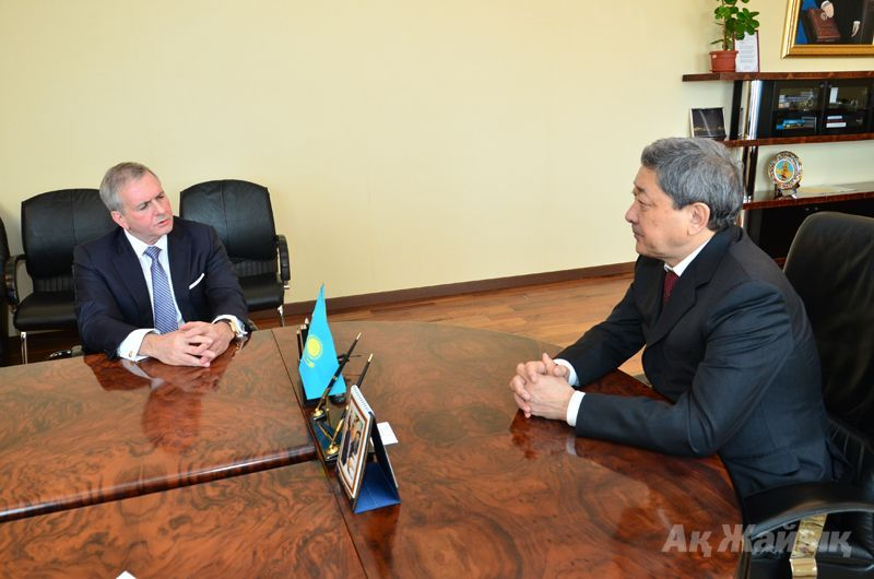 Scott Davis of Chevron (left) meeting governor Izmukhambetov