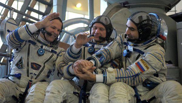 Kevin Ford, Oleg Novitsky, Yevgeny Tarelkin