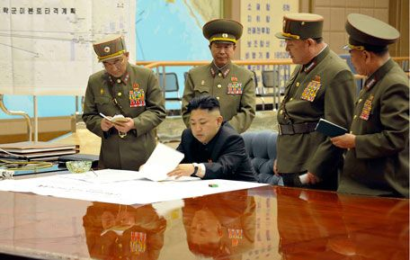 North Korean leader Kim Jong-un (C) presides over an urgent operation meeting on the Korean People's Army Strategic Rocket Force's performance of duty for firepower strike at the Supreme Command in Pyongyang. (REUTERS)