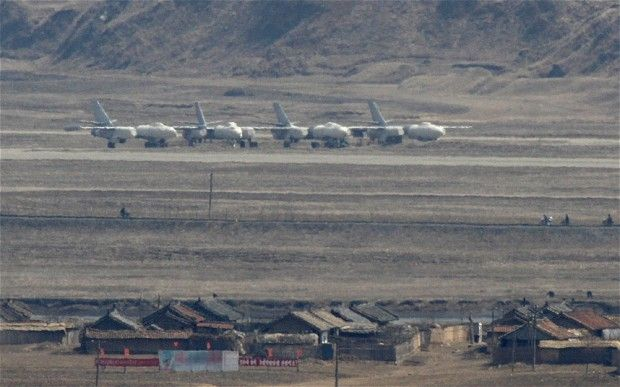 North Korean Harbin H-5 bomber jets at Uiju Airfield near the North Korean town of Sinuiju, opposite the Chinese border city of Dandong Photo: REUTERS/Jacky Chen