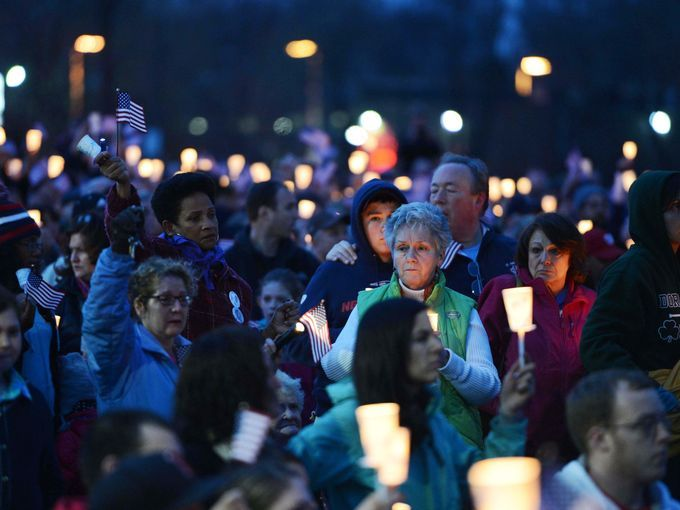 Hundreds gather in Garvey Park in Dorchester near the home of Martin Richard for a candlelight vigil in honor of the victims of the Boston Marathon bombings.  Credit: USA Today