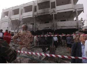 People stand among debris outside the French embassy after the building was attacked, in Tripoli - Source: Reuters