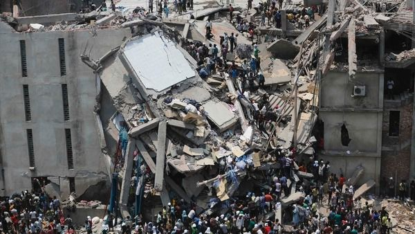 People rescue garment workers trapped under rubble at the Rana Plaza building after it collapsed, in Savar, 30 km (19 miles) outside Dhaka April 24, 2013. (Reuters)