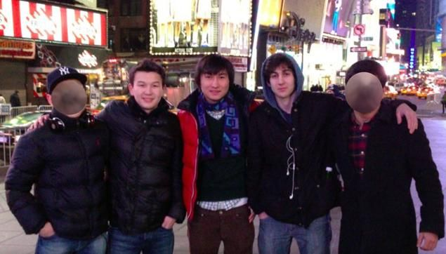 Boston Marathon bombing Dzhokhar Tsarnaev (second from right) stands with Azamat Tazhayakov (second from left) and Dias Kadyrbayev (center) in Times Square. Tsarnaev revealed intentions to bomb Times Square, and Tazhayakov and Kadyrbayev were both arrested for visa violations on Saturday.