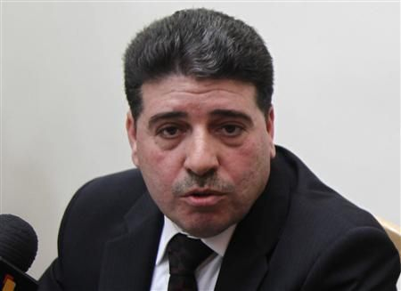 Syrian Prime Minister Wael al-Halki speaks to the media at his office in Damascus, April 3, 2012. Credit: Reuters