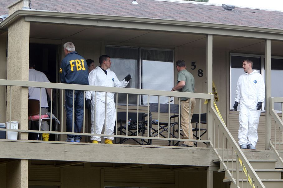 Federal authorities search an apartment in Boise, Idaho on Cassia Drive on Thursday afternoon, May 16 2013. U.S. authorities in Idaho said they have arrested a man from Uzbekistan accused of conspiring with a designated terrorist organization in his home country and helping scheme to use a weapon of mass destruction. Fazliddin Kurbanov, 30, was arrested at an apartment complex
