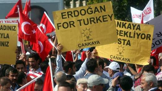Supporters of Mr Erdogan wave placards @Sky News