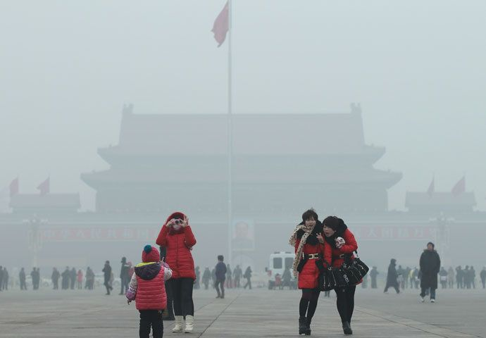 Visitors take pictures on Tiananmen Square during a foggy day in central Beijing, January 29, 2013. China issued a blue-coded alert on Sunday as foggy weather forecast for the coming two days will cut visibility and worsen air pollution in some central and eastern Chinese cities, Xinhua News Agency reported.(Reuters / China Daily)