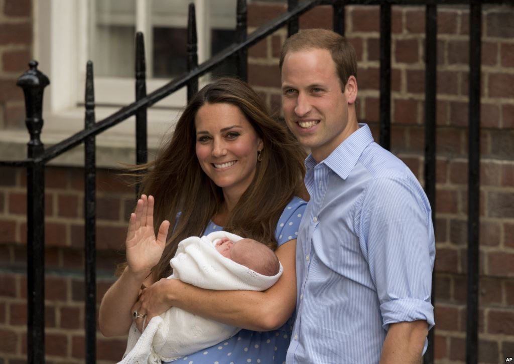 Prince William and Kate, Duchess of Cambridge, hold the Prince of Cambridge
