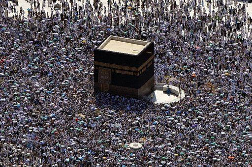 An aerial view shows hajj pilgrims circling the Kaaba at the Grand mosque in Mecca, on October 27, 2012.