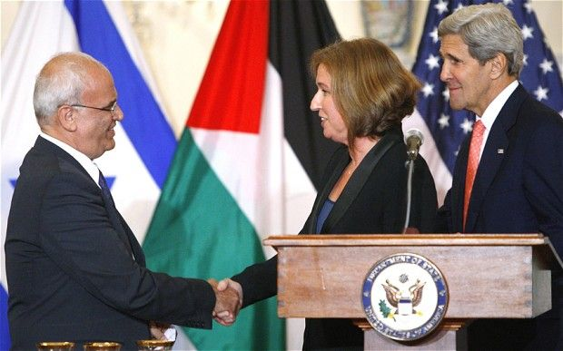 Chief Palestinian negotiator Saeb Erekat, left, shakes hands with Israel's Justice Minister Tzipi Livni  Photo: Reuters