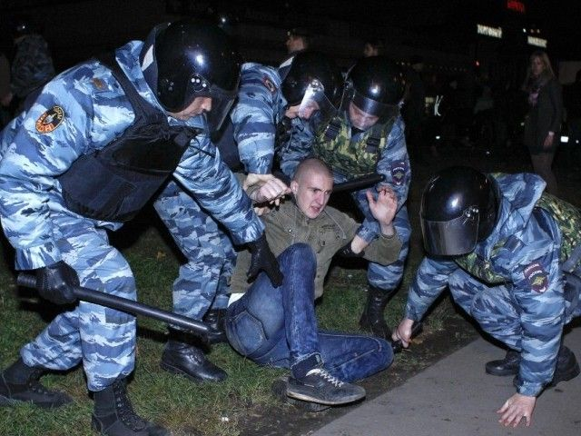 Russian police detain a man after a protest in the Biryulyovo district of Moscow October 13, 2013. PHOTO: REUTERS