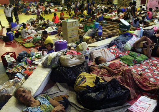 Filipino residents sleep on the floor at a gymnasium turned into an evacuation center in Sorsogon City, Bicol region, Philippines, on Nov. 7.(Photo: Kit Recebido, epa)