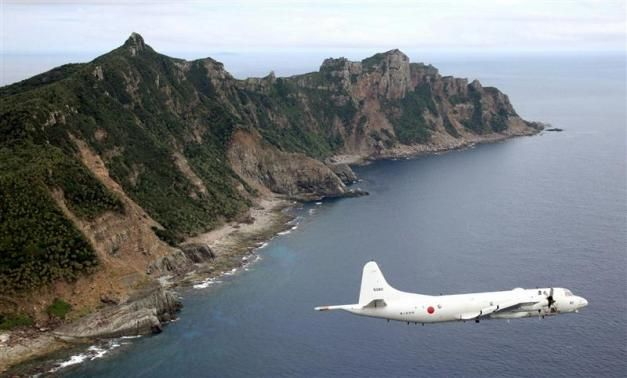 Japan Maritime Self-Defense Force's PC3 surveillance plane flies around the disputed islands in the East China Sea, known as the Senkaku isles in Japan and Diaoyu in China.@Reuters.