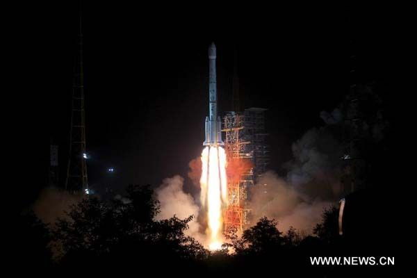 The Long March-3B carrier rocket carrying China's Chang'e-3 lunar probe blasts off from the launch pad at Xichang Satellite Launch Center, southwest China's Sichuan Province, Dec.2, 2013. It will be the first time for China to send a spacecraft to soft land on the surface of an extraterrestrial body, where it will conduct surveys on the moon.