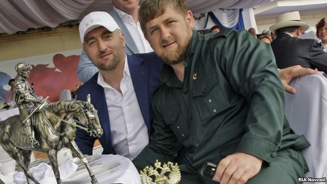 Russian Duma deputy Adam Delimkhanov (left, seen with Chechen leader Ramzan Kadyrov at an annual horse race in the Rostov-na-Donu) is one of the two deputies reportedly involved in the December 3 fight.