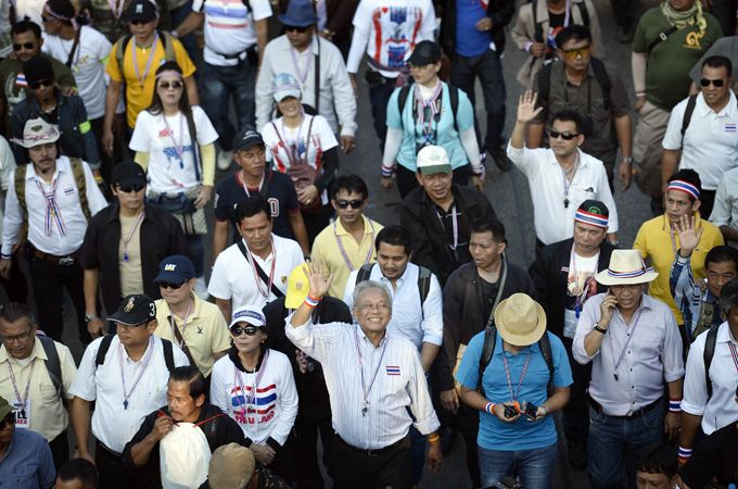 Protest leader Suthep, center, and supporters vowed to swarm Bangkok streets in