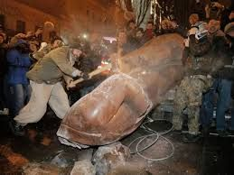 A Ukrainian protester slams a toppled monument of Vladimir Lenin in Kiev, Ukraine, on Sunday, December 8. Ukrainians occupied the square to denounce President Viktor Yanukovich's decision to turn away from Europe and align this ex-Soviet republic with Russia, as protests continued for a third week