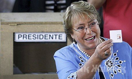 Michelle Bachelet after voting at a polling station in La Reina commune, near Santiago de Chile. Photograph: Felipe Trueba/EPA