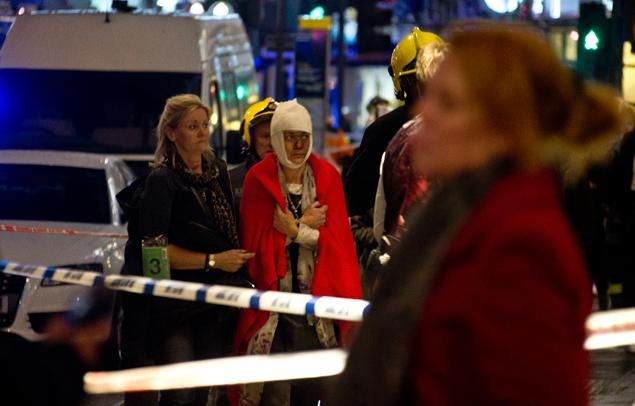 A woman stands bandaged and wearing a blanket given by emergency services following a roof collapse at the Apollo Theatre on London's Shaftesbury Ave. Thursday evening.  Read more: http://www.nydailynews.com/news/world/balcony-collapses-apollo-theatre-central-london-article-1.1553139#ixzz2nz834wOv