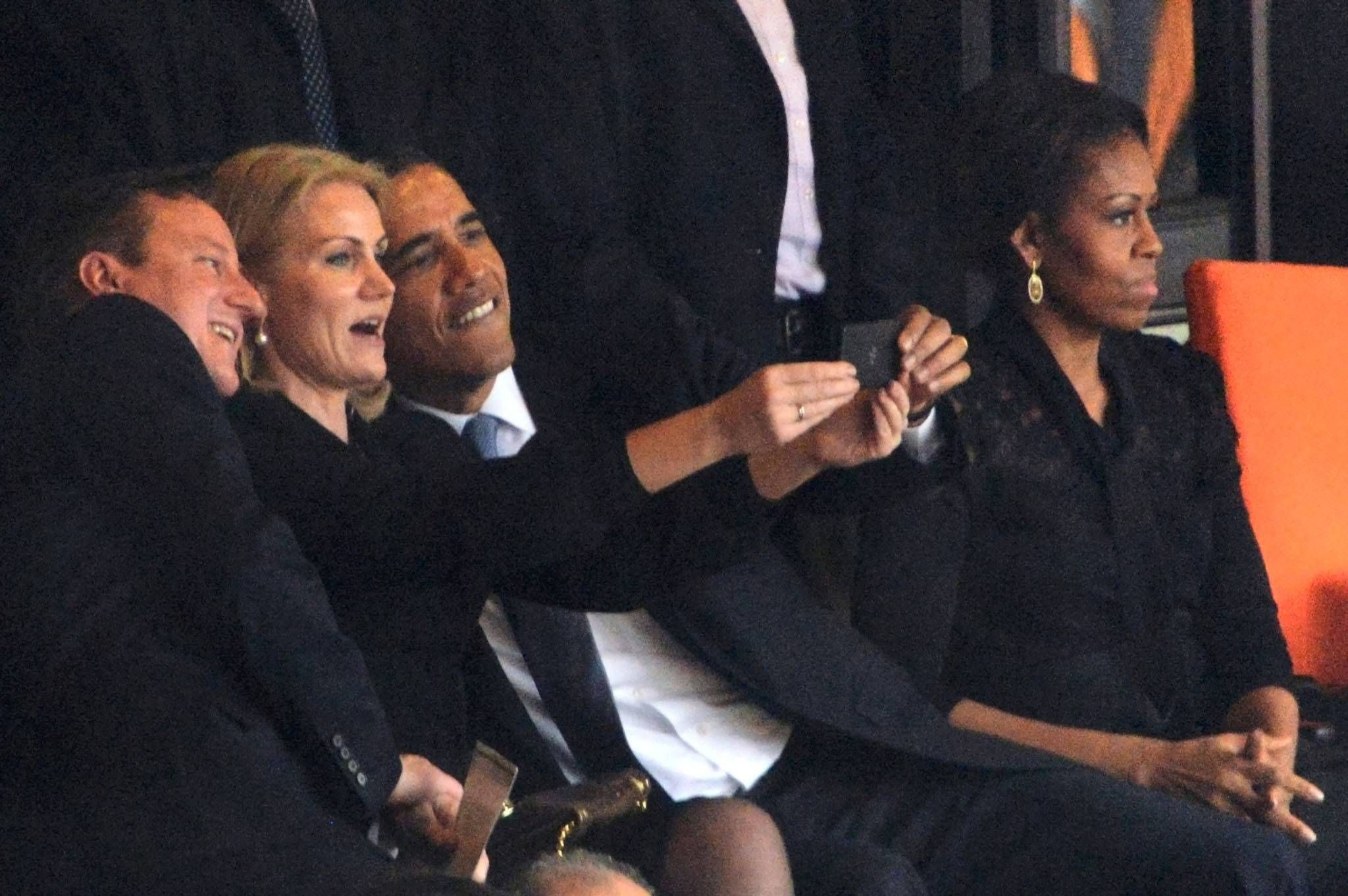 Obama and Cameron cosy up for 'inappropriate' selfie with Danish PM at Nelson Mandela's memorial service