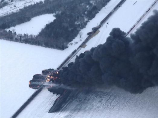 Smoke rises from scene of a derailed train near Casselton, North Dakota December 30, 2013.