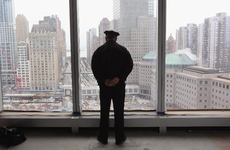 New York policeman overlooking Ground Zero.