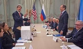 US Secretary of State John Kerry (L) holds Idaho potatoes as a gift for Russia's Foreign Minister Sergei Lavrov
