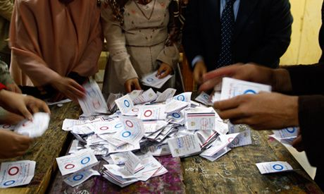 Egyptian election workers count ballots at the end of the second, final day of a key referendum on a new constitution, inside a polling station in Cairo, Egypt, Wednesday, Jan. 15, 2014.
