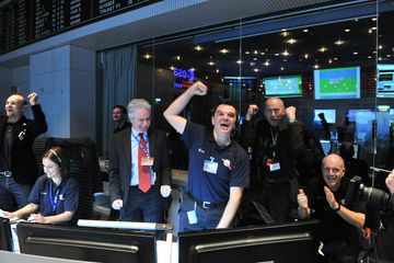 Rosetta mission scientists cheer as the comet-chasing probe's first signal after awaking from a 2.5-year sleep is received at the European Space Agency's Space Operations Center in Darmstadt, Germany on Jan. 20, 2014. Credit: ESA