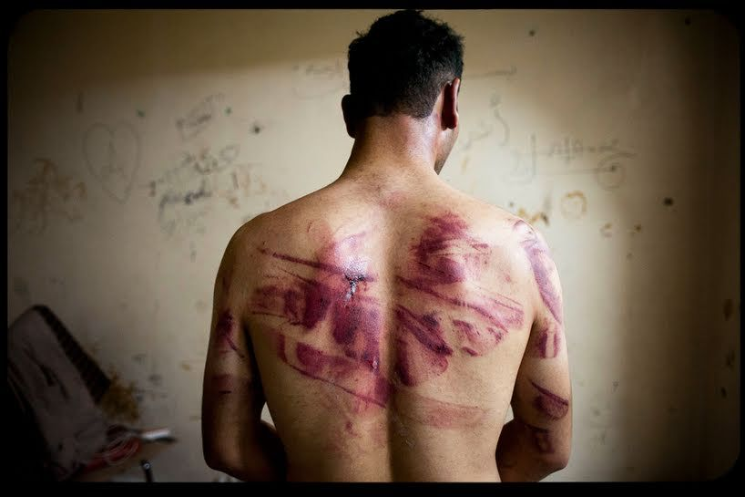 "A Syrian military police photographer has supplied ""clear evidence"" showing the systematic torture and killing of about 11,000 detainees"
