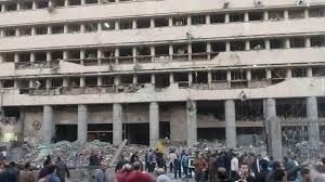 Cairo security directorate after deadly explosion, Jan 24, 2014