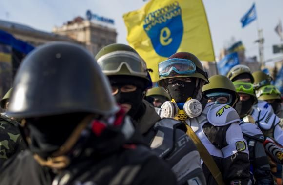 Members of various anti-government paramilitary groups gather at Independence Square during a show of force in Kiev, January 29, 2014.
