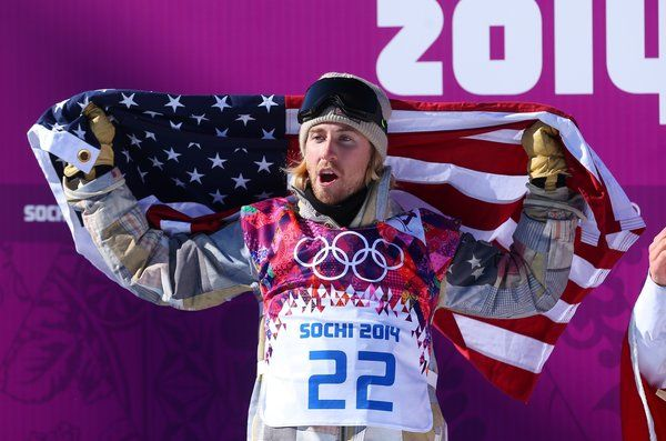 Sage Kotsenburg celebrates after winning the gold medal in the men's snowboard slopestyle on Saturday at Rosa Khutor Extreme Park. (Getty Images / Feb 8, 2014)
