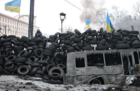 A wall of tyres built by anti-government protesters in Kiev. Photograph: Itar-Tass/Barcroft Media