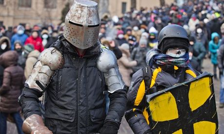 Ukrainian protesters take to the streets in homemade suits of armour. Photograph: Evgeny Feldman/AP