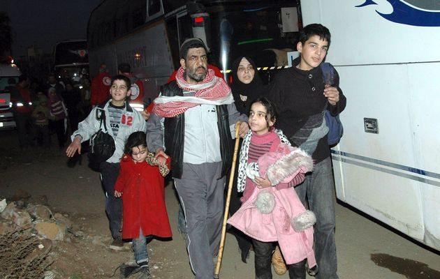 A family from a besieged area of Homs arrive to the area under government control February 9, 2014. n this handout released by Syria's national news agency SANA.  Image by: SANA / REUTERS