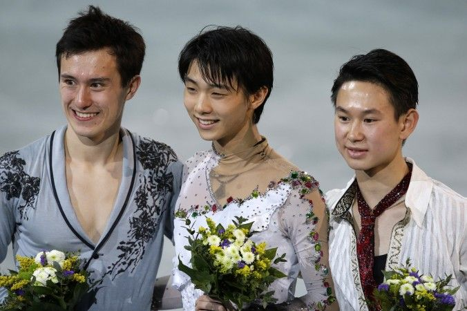 Denis Ten of Kazakhstan (R), Yuzuru Hanyu of Japan (C), Patrick Chan of Canada (L) on the podium during the flower ceremony for the men's free skate figure skating final during the 2014 Winter Olympics, Friday, Feb. 14, 2014, in Sochi (AP photo)