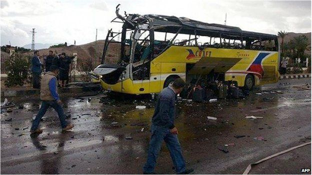 The wreckage of a tourist bus at the site of an explosion in the Egyptian town of Taba No group has said it carried out the attack