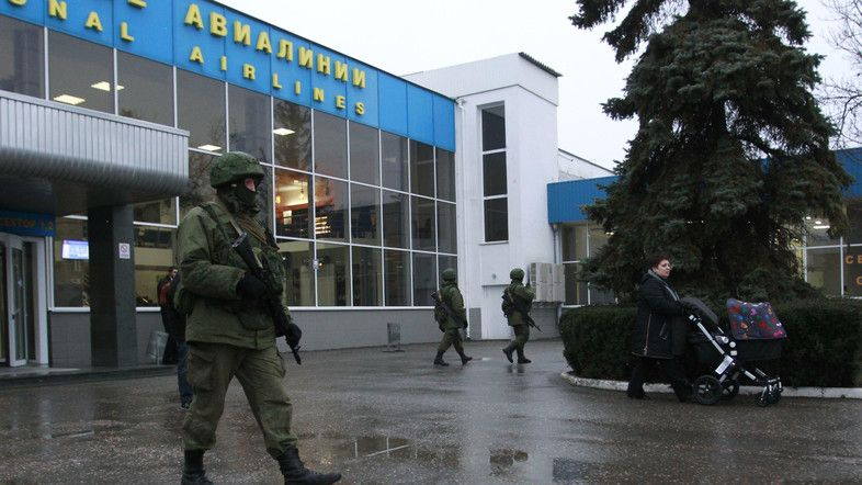 Armed men patrol at the airport in Simferopol, Crimea February 28, 2014. (Reuters)