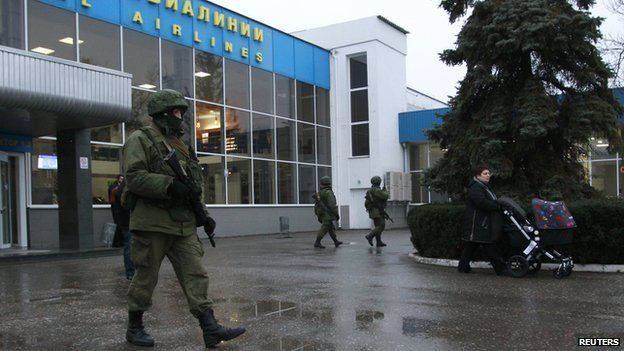 Armed men arrived at Simferopol airport in several trucks, and carrying Russian navy flags